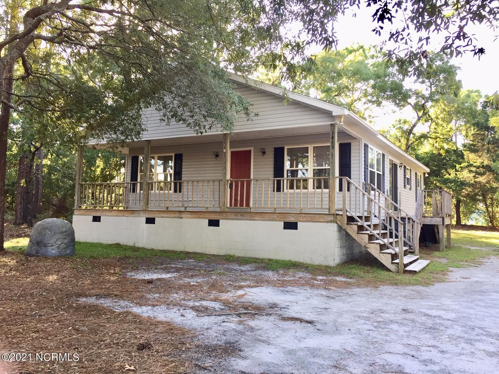 Photo of 1443 E Boiling Spring Road, Southport, NC 28461 (MLS # 100289408)