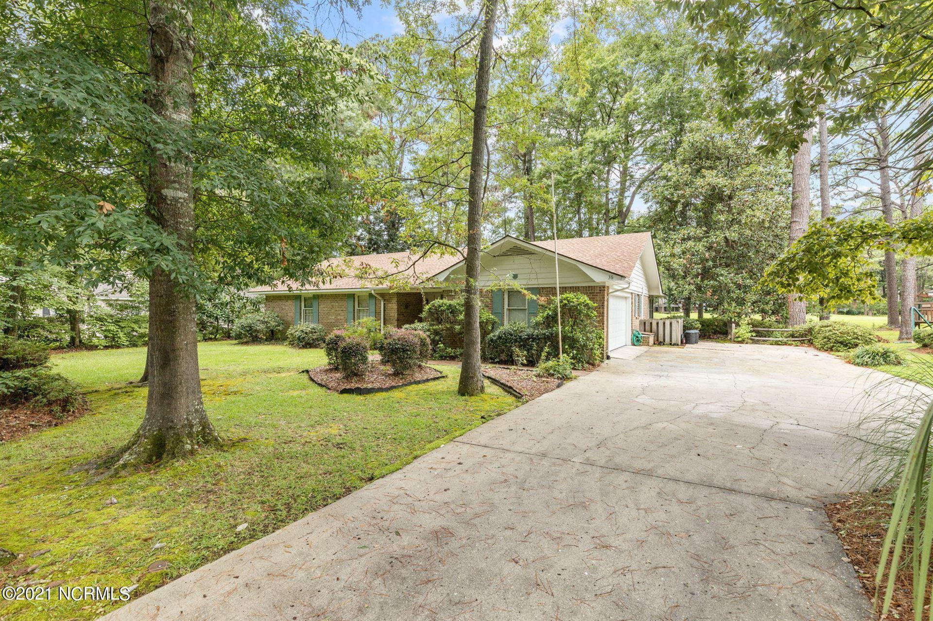 Photo of 36 Swamp Fox Drive, Carolina Shores, NC 28467 (MLS # 100284426)