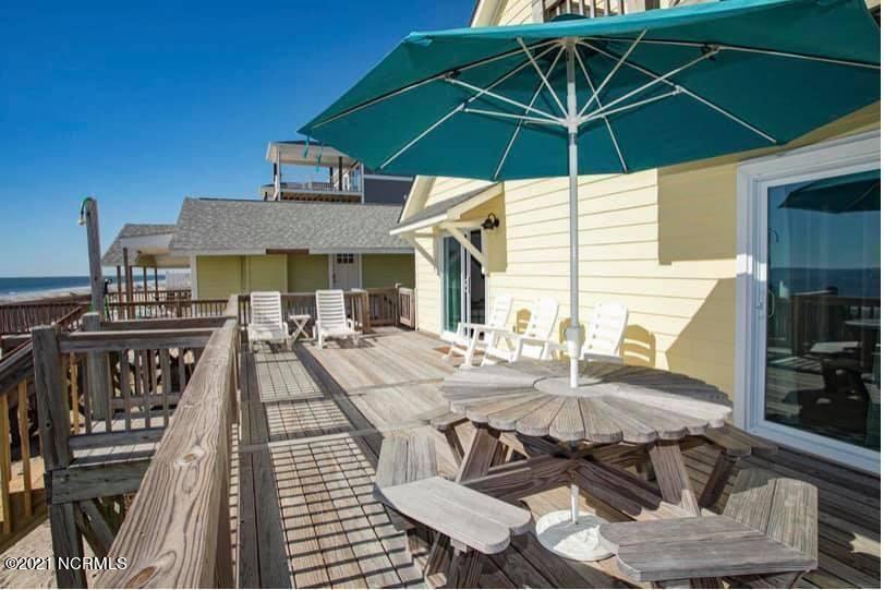 Photo of 3719 E Beach Drive, Oak Island, NC 28465 (MLS # 100295428)