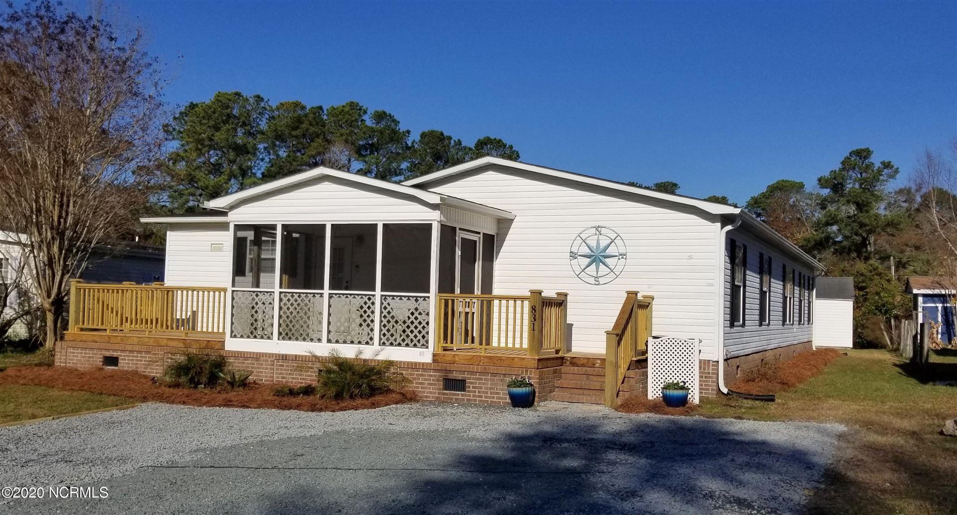 Photo of 831 Magnolia Drive, Sunset Beach, NC 28468 (MLS # 100296432)