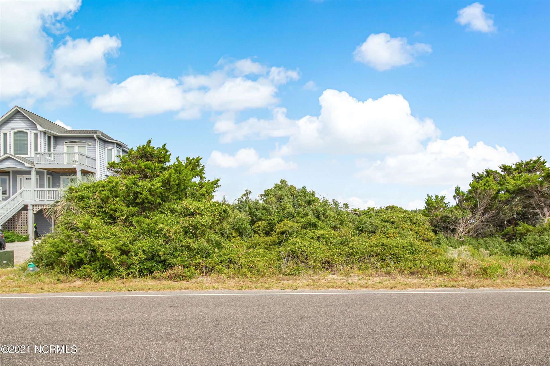 Photo of L-25 Caswell Beach Road, Caswell Beach, NC 28465 (MLS # 100295441)