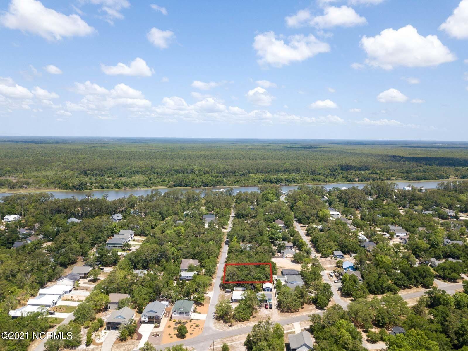 Photo of 102 NW 22nd Street, Oak Island, NC 28465 (MLS # 100272453)