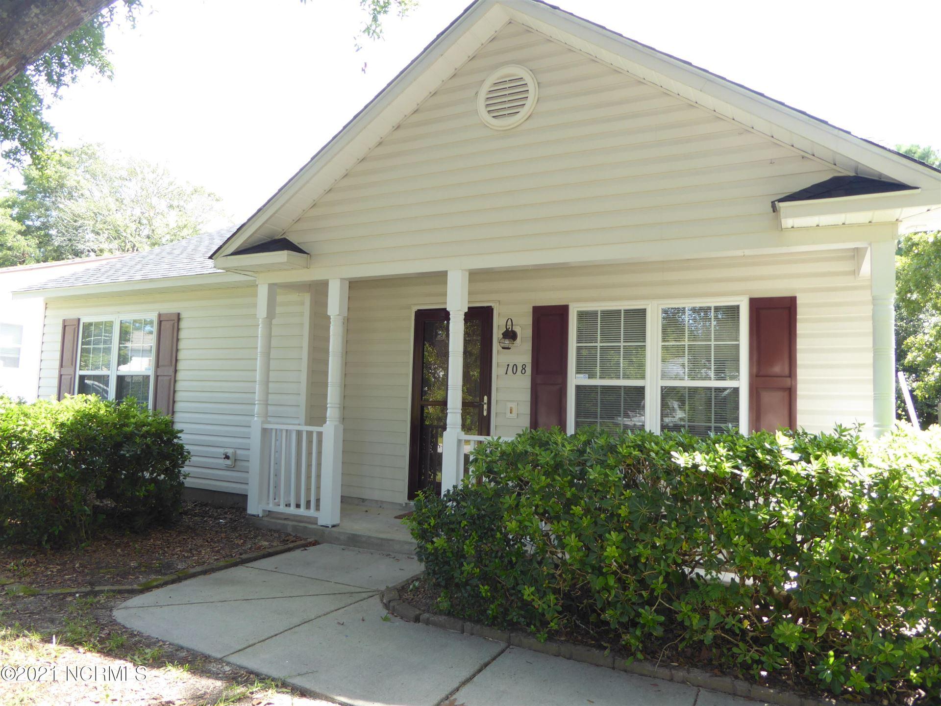 Photo of 108 NW 13th Street, Oak Island, NC 28465 (MLS # 100289497)