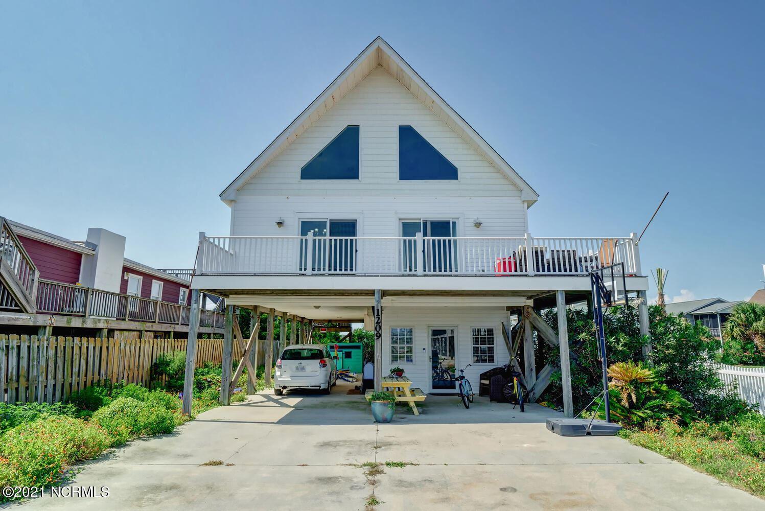 Photo of 1209 N Topsail Drive, Surf City, NC 28445 (MLS # 100285520)