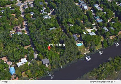 Photo of 124 SW 4th Street, Oak Island, NC 28465 (MLS # 100271521)