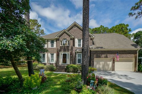 Photo of 504 Periwinkle Way, Caswell Beach, NC 28465 (MLS # 100228525)