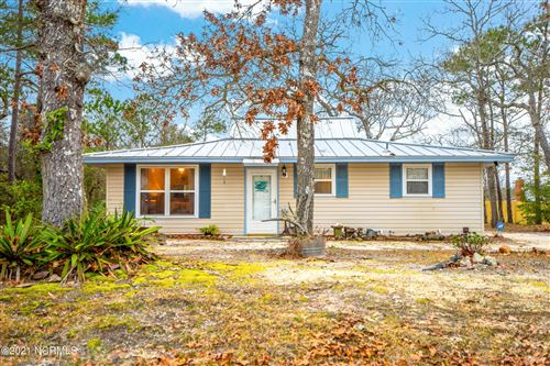 Photo of 125 NW 10th Street, Oak Island, NC 28465 (MLS # 100259554)
