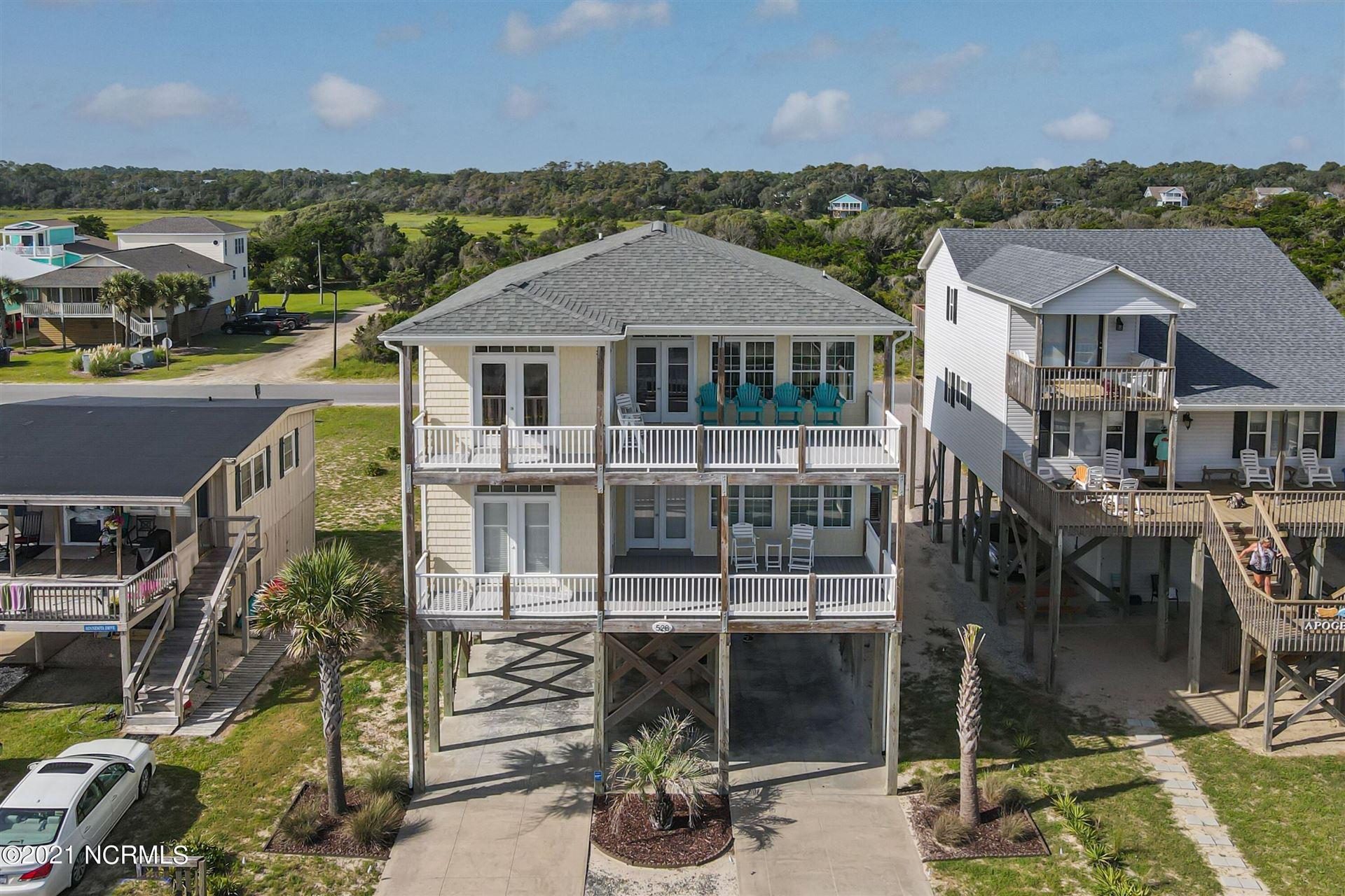 Photo of 528 W Beach Drive, Oak Island, NC 28465 (MLS # 100288555)