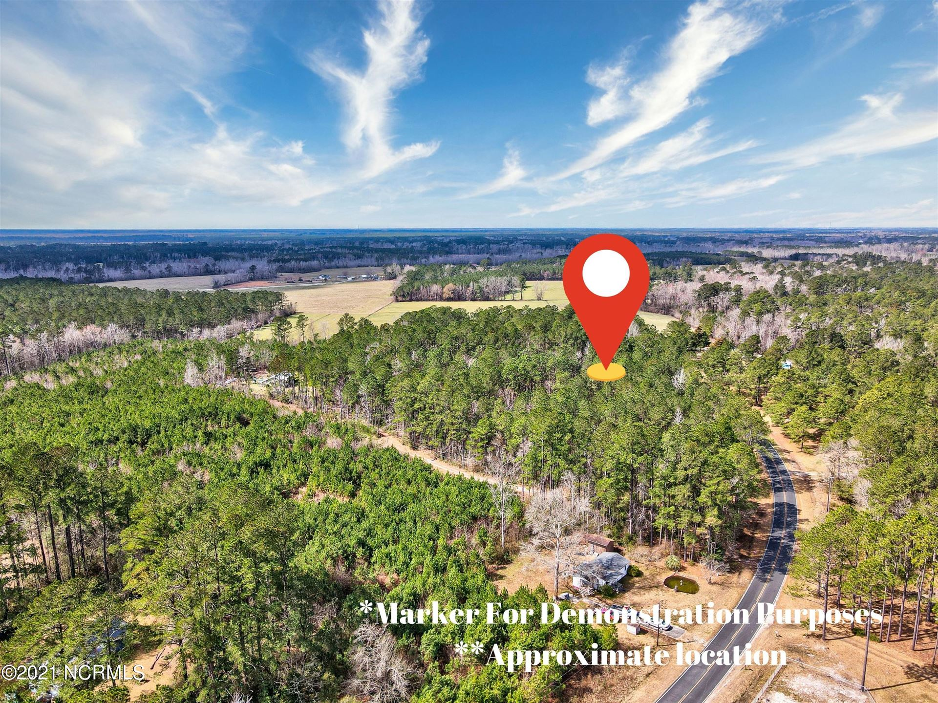 Photo of T-3 8ac Stout Road NW, Ash, NC 28420 (MLS # 100251575)