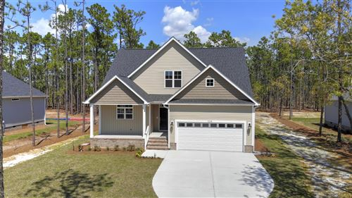Photo of 1124 Nicklaus Road, Southport, NC 28461 (MLS # 100208583)