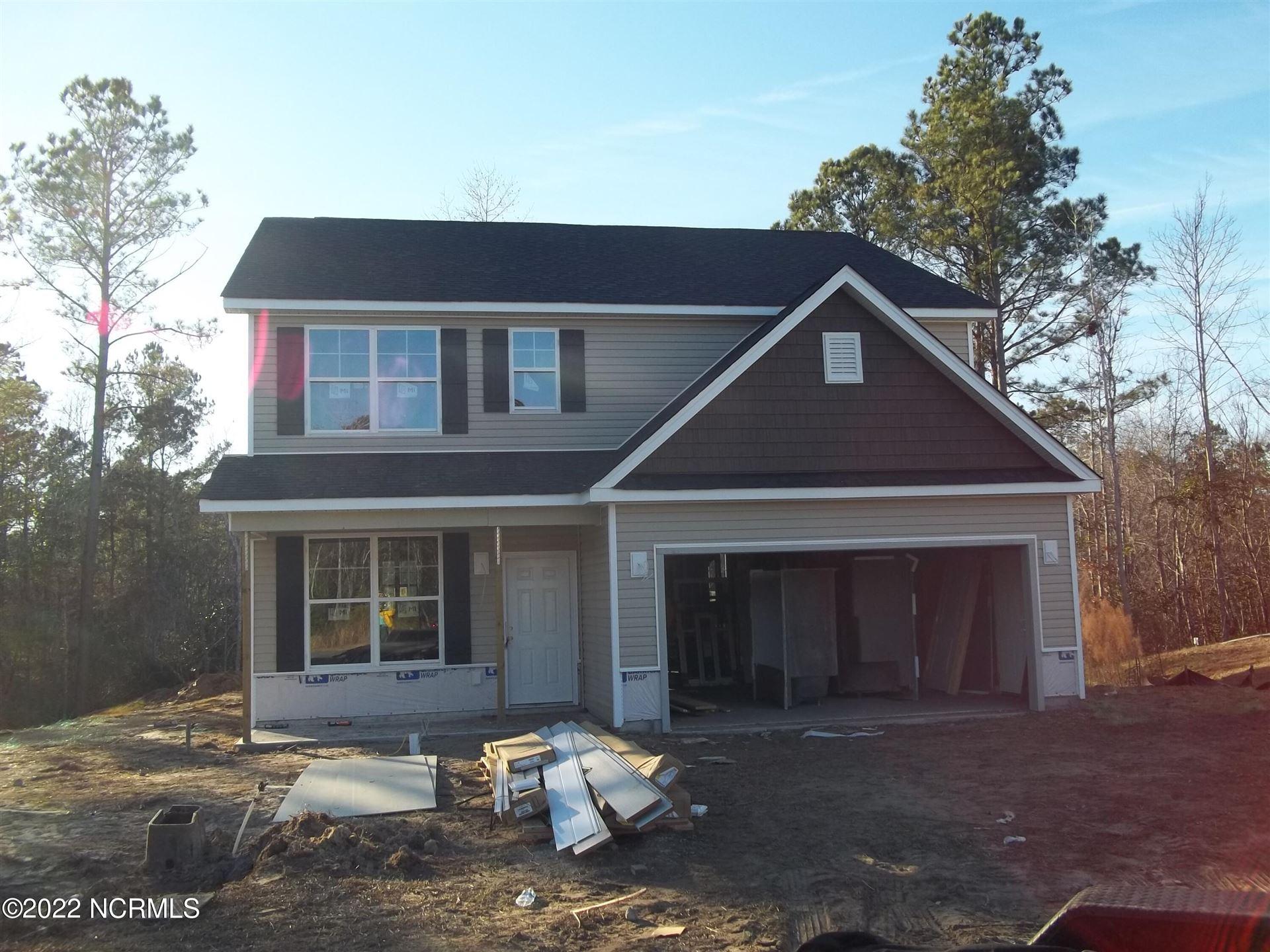 Photo of 923 W W Arboria Drive, Hampstead, NC 28443 (MLS # 100284585)