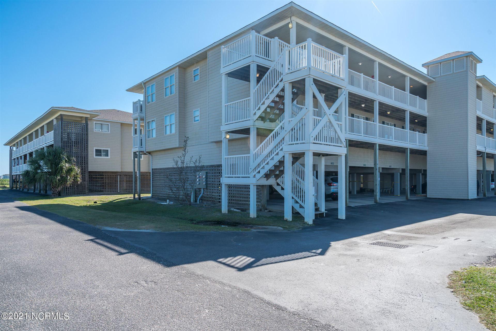 Photo of 122 SE 58th Street #Apt 202, Oak Island, NC 28465 (MLS # 100295591)