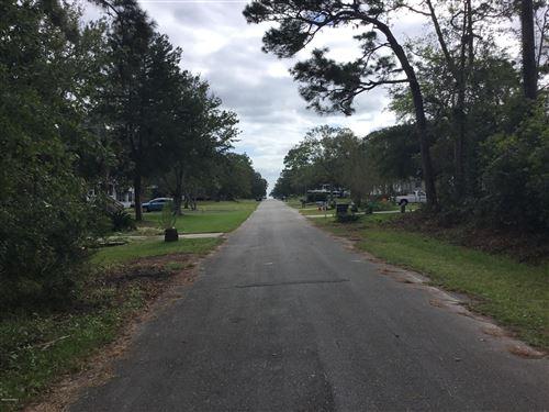 Photo of 236 NE 70th Street, Oak Island, NC 28465 (MLS # 100237603)