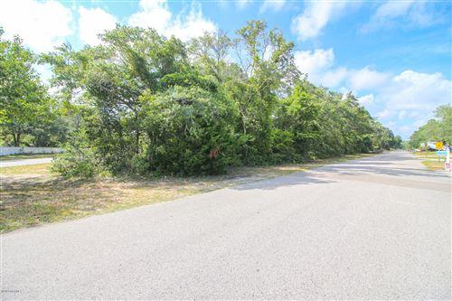 Photo of 2808 E Oak Island Drive, Oak Island, NC 28465 (MLS # 100229604)