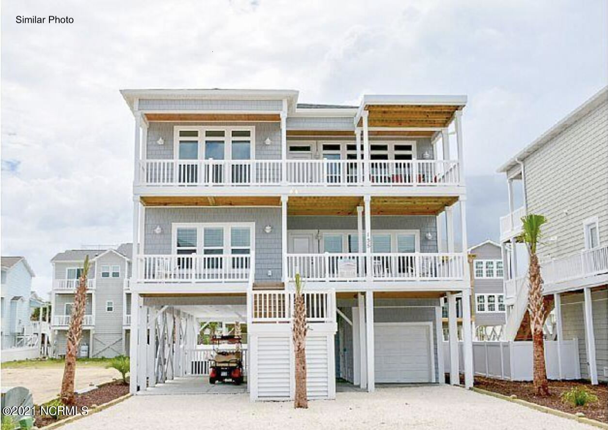Photo of 1961 New River Inlet Road, North Topsail Beach, NC 28460 (MLS # 100293611)