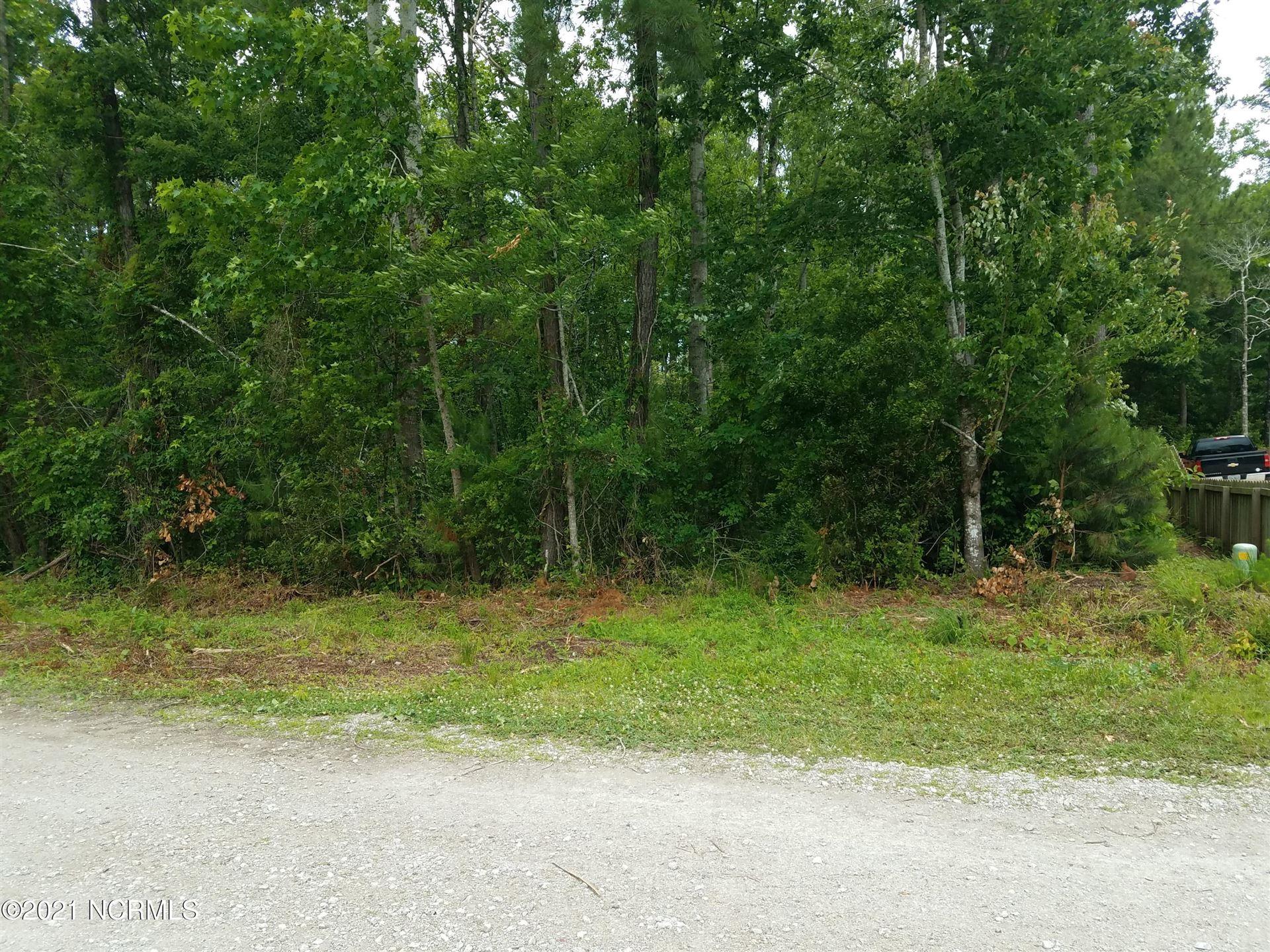 Photo of 37 Doral Drive, Hampstead, NC 28443 (MLS # 100274634)