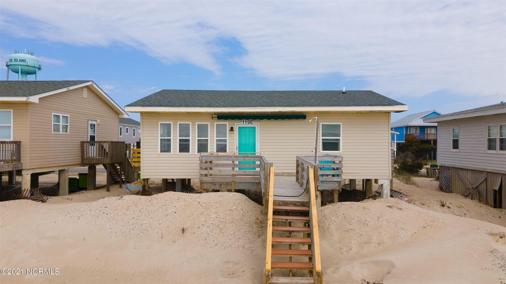 Photo of 119 E Beach Drive, Oak Island, NC 28465 (MLS # 100257635)