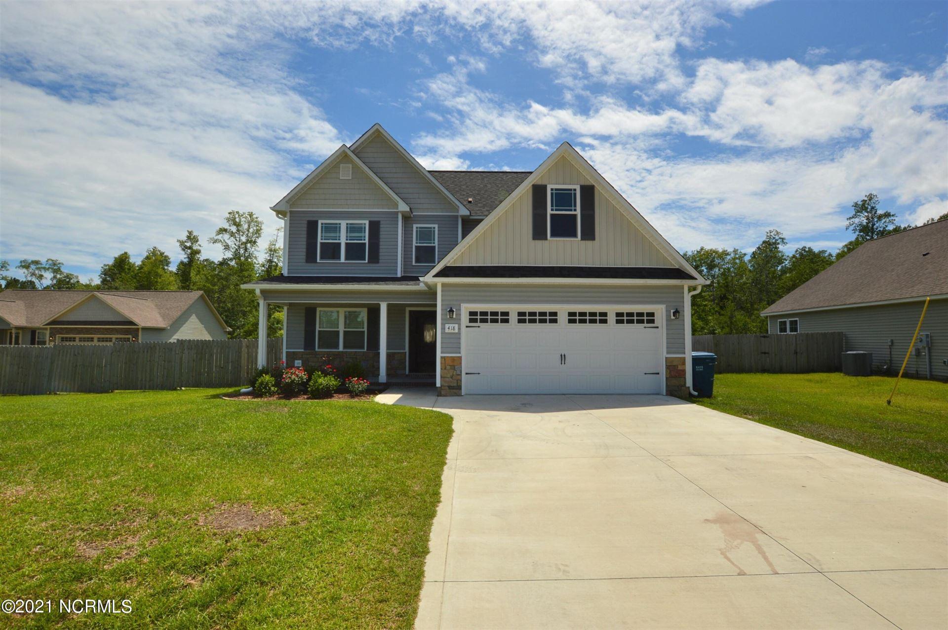 Photo of 418 Mccall Drive, Jacksonville, NC 28540 (MLS # 100285636)