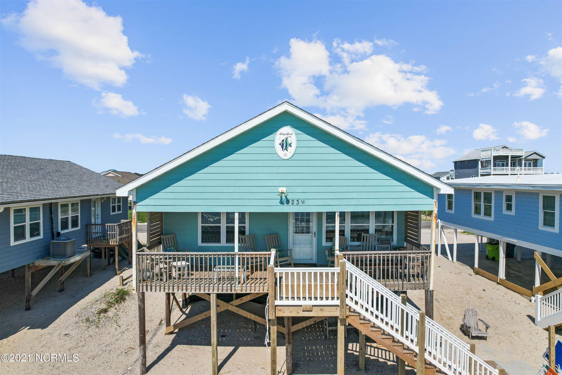 Photo of 1323 W Beach Drive, Oak Island, NC 28465 (MLS # 100293636)