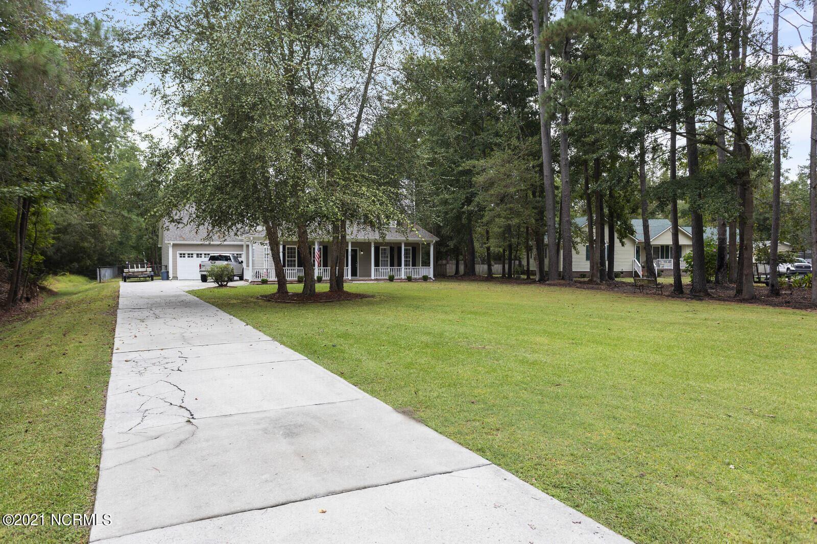 Photo of 325 Morgan Cove Drive, Burgaw, NC 28425 (MLS # 100294641)
