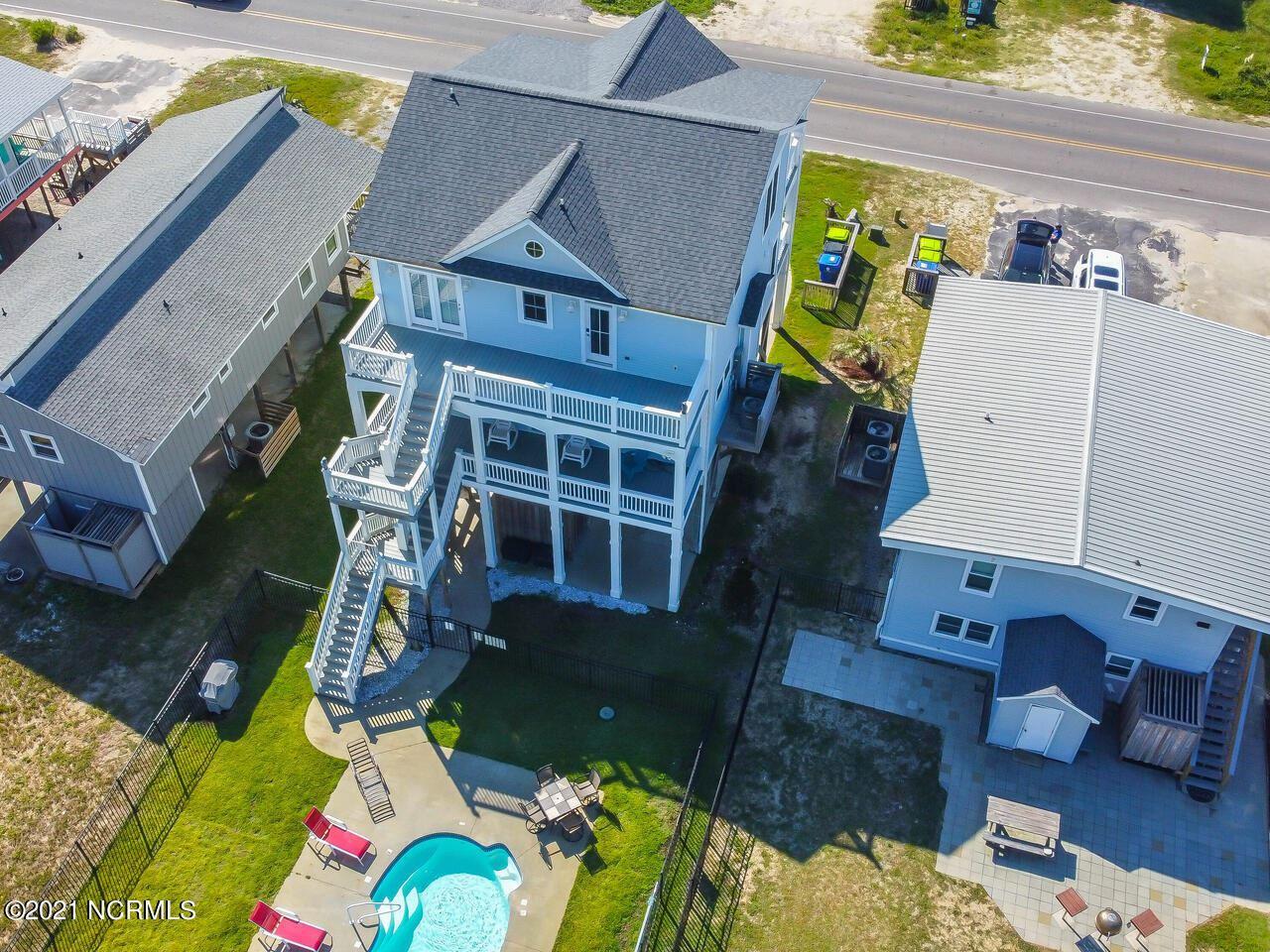 Photo of 2518 W Beach Drive, Oak Island, NC 28465 (MLS # 100291656)