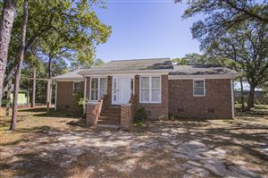 Photo of 214 NE 60th Street, Oak Island, NC 28465 (MLS # 100188657)