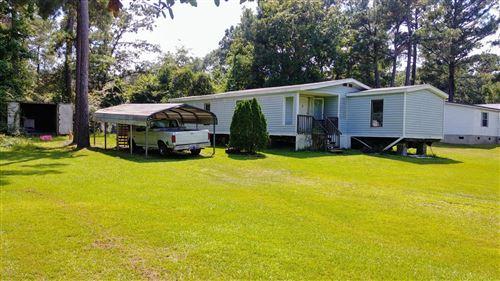 Photo of 660 Bay Harbor Drive, Hampstead, NC 28443 (MLS # 100201661)