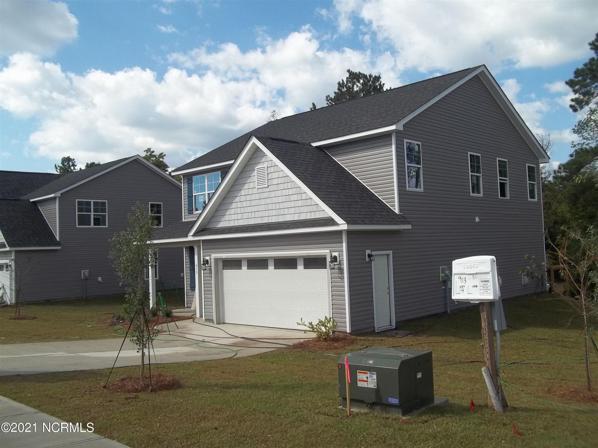 Photo of 915 W Arboria Drive, Hampstead, NC 28443 (MLS # 100284674)