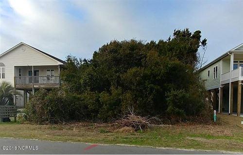 Photo of 2606 E Dolphin Drive, Oak Island, NC 28465 (MLS # 100104701)