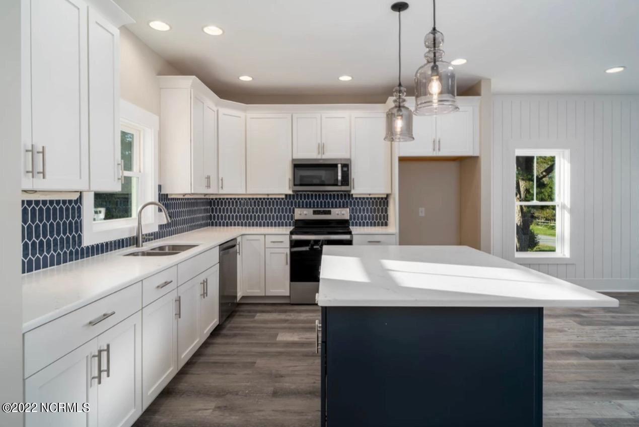 Photo of 3406 E Oak Island Drive, Oak Island, NC 28465 (MLS # 100294731)