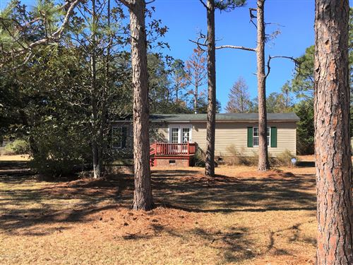 Photo of 872 Cambridge Road, Boiling Spring Lakes, NC 28461 (MLS # 100205733)