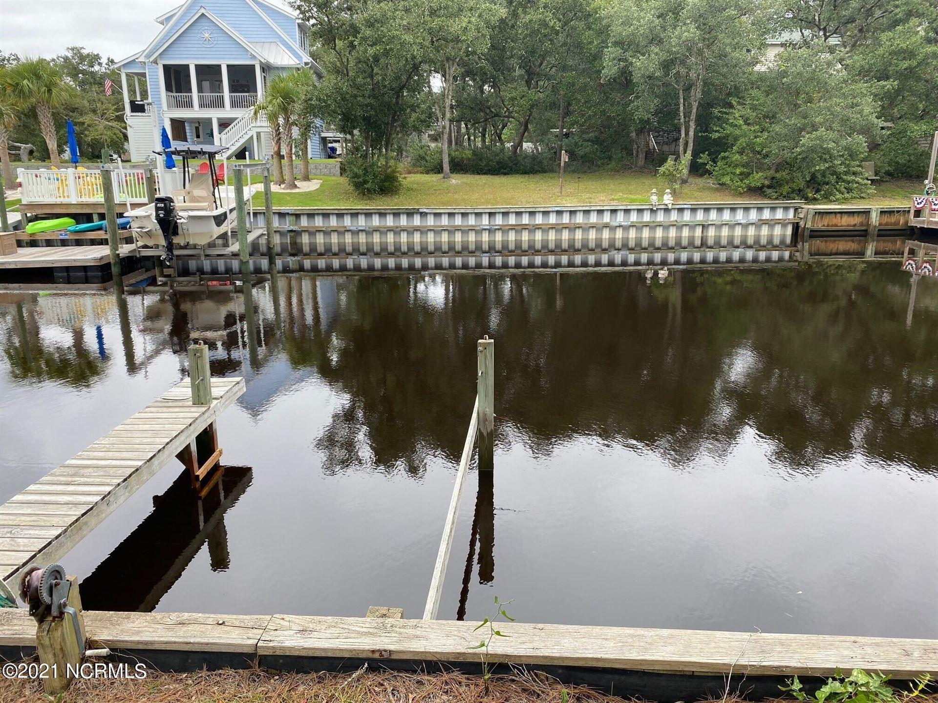 Photo of 104 E Island Drive, Oak Island, NC 28465 (MLS # 100294735)