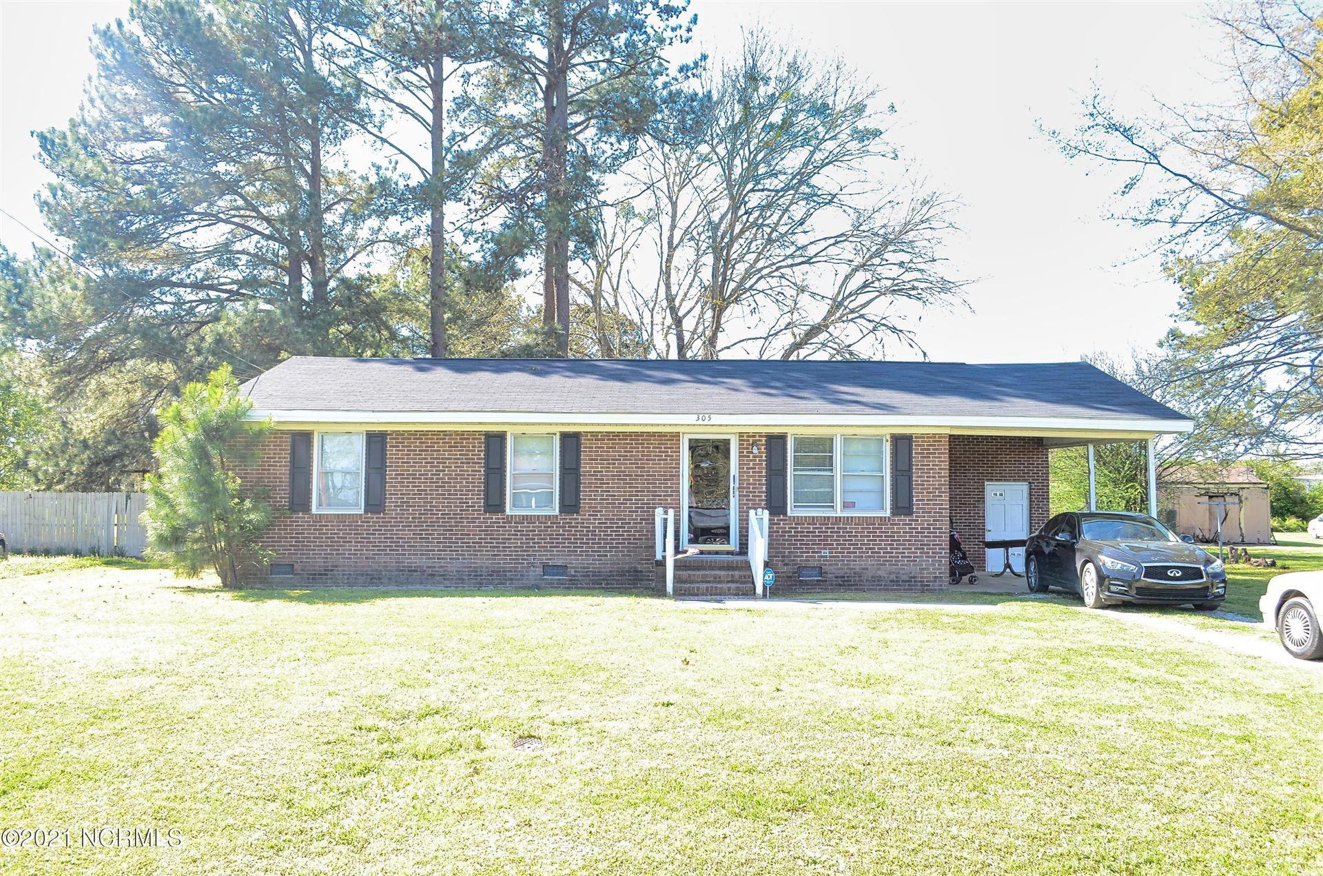 Photo of 305 Minshall Drive, Stantonsburg, NC 27883 (MLS # 100264739)