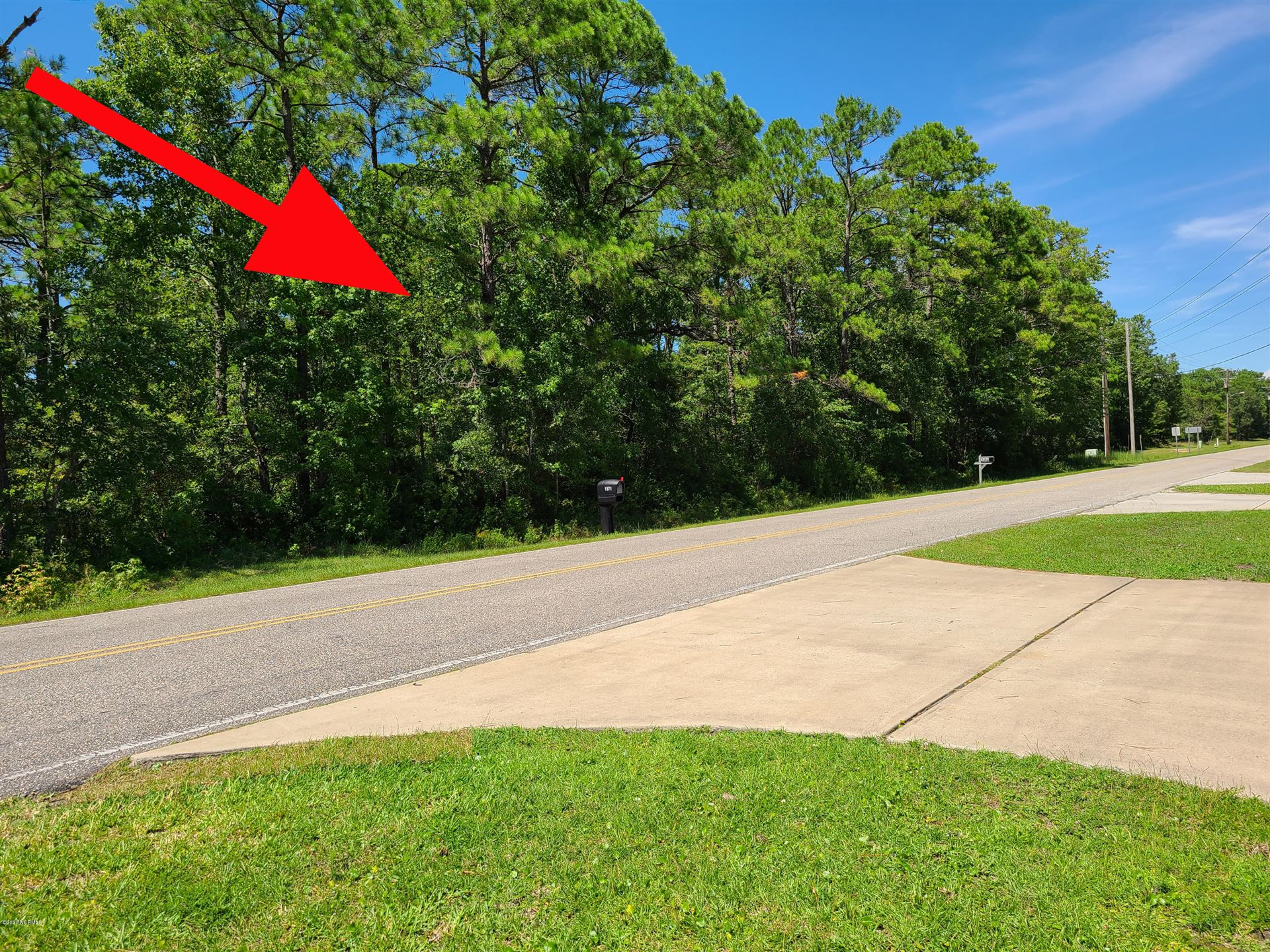 Photo of 1360 Thomasboro Road SW, Carolina Shores, NC 28467 (MLS # 100228744)
