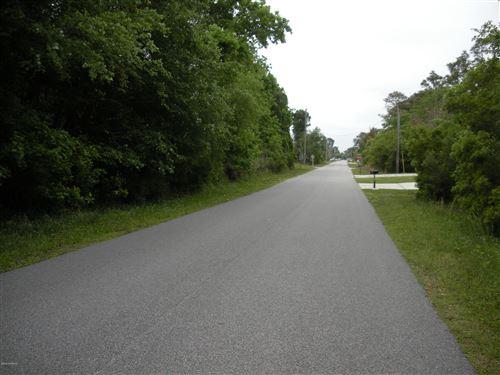 Photo of 1409 Searay Lane, Carolina Beach, NC 28428 (MLS # 100222746)