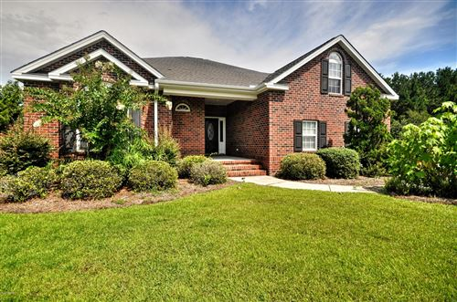 Photo of 1140 Moultrie Drive NW, Calabash, NC 28467 (MLS # 100230795)