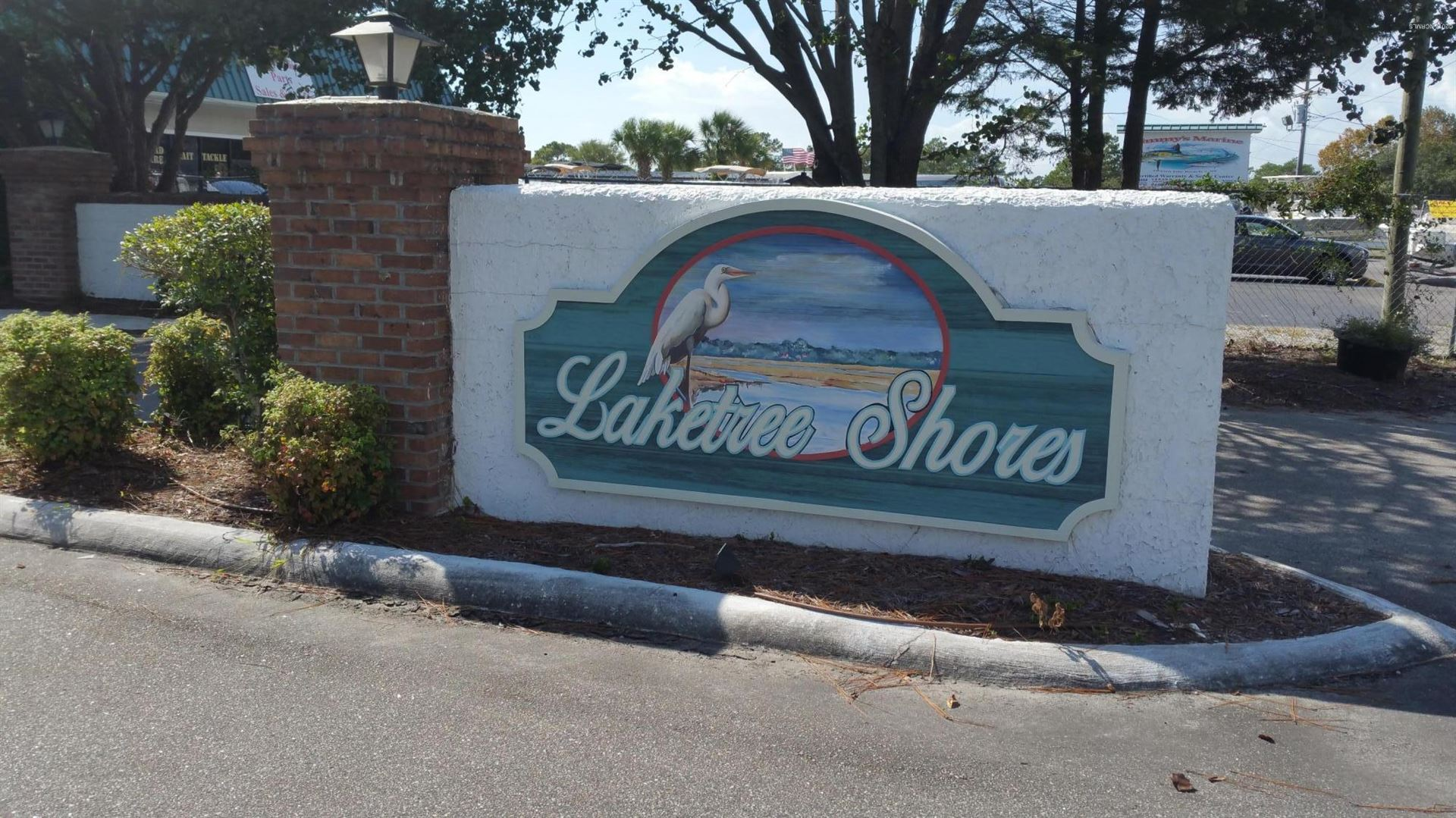 Photo of 1691 Lake Tree Drive SW, Ocean Isle Beach, NC 28469 (MLS # 100085848)