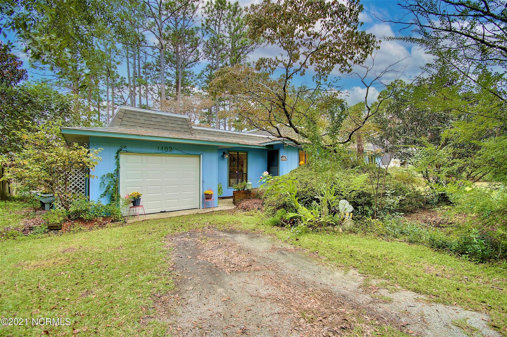 Photo of 1402 N Shore Drive, Southport, NC 28461 (MLS # 100294859)
