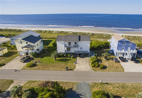 Photo of 303 Ocean Drive, Oak Island, NC 28465 (MLS # 100224882)