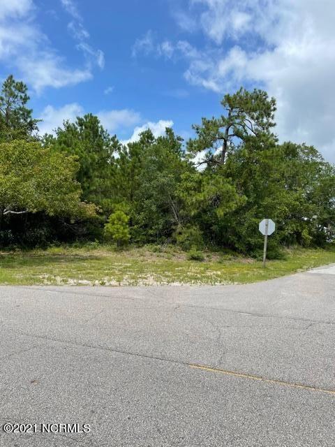 Photo of 2302&2304 W Oak Island Drive, Oak Island, NC 28465 (MLS # 100282895)