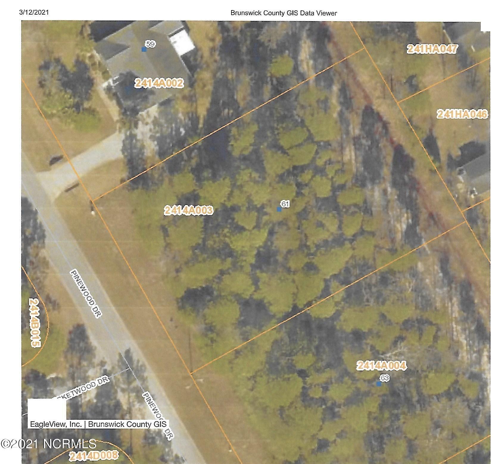 Photo of 61 Pinewood Drive, Carolina Shores, NC 28467 (MLS # 100260908)