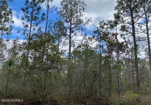 Photo of 671 Sunset Road, Southport, NC 28461 (MLS # 100192910)