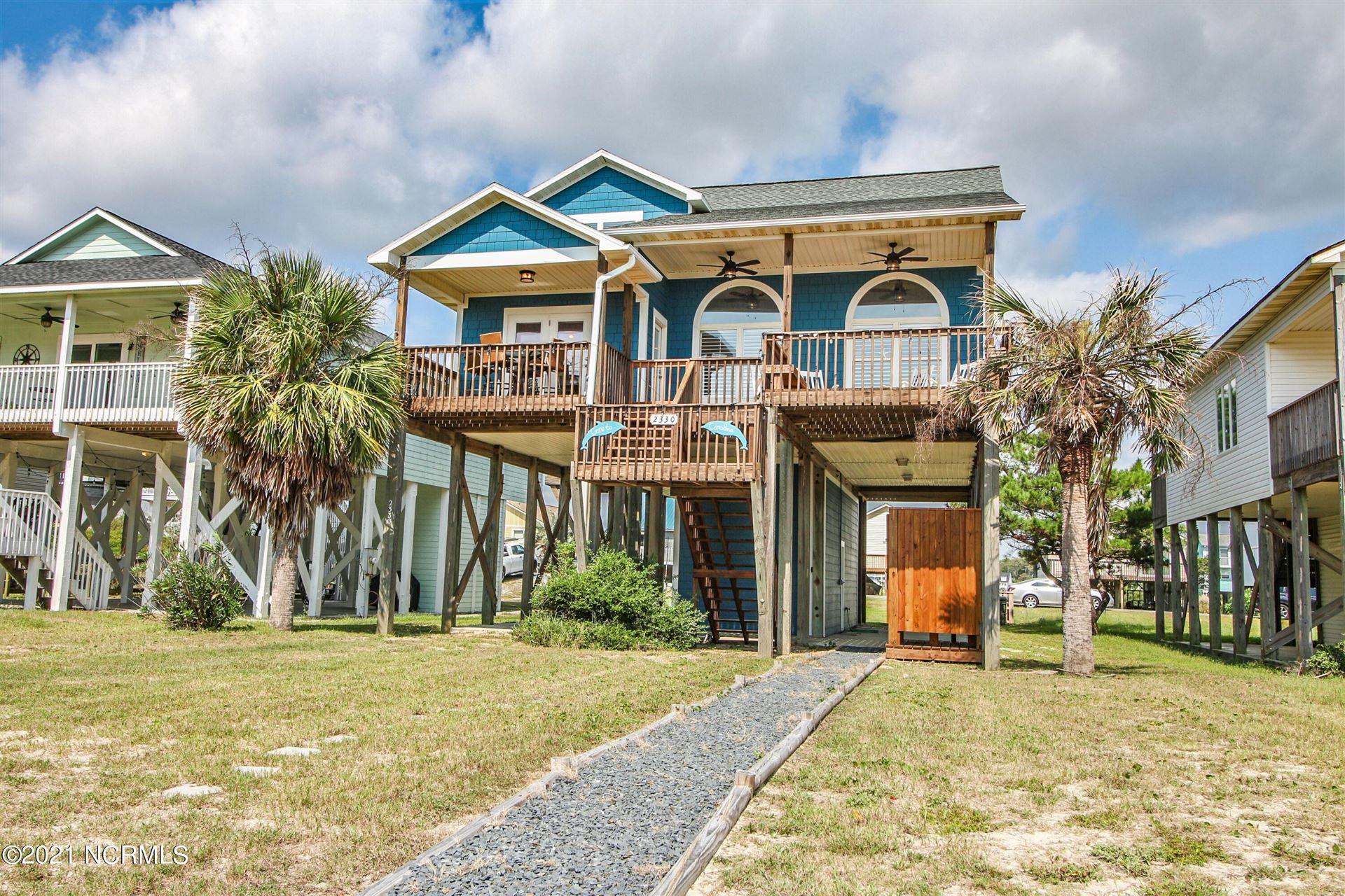 Photo of 2330 W Beach Drive, Oak Island, NC 28465 (MLS # 100292910)
