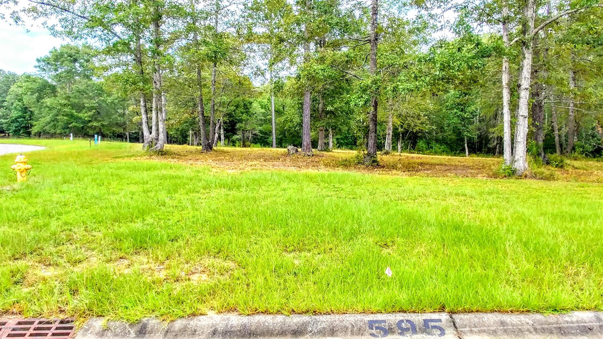 Photo of 595 Sanctuary Point SW, Supply, NC 28462 (MLS # 100181916)