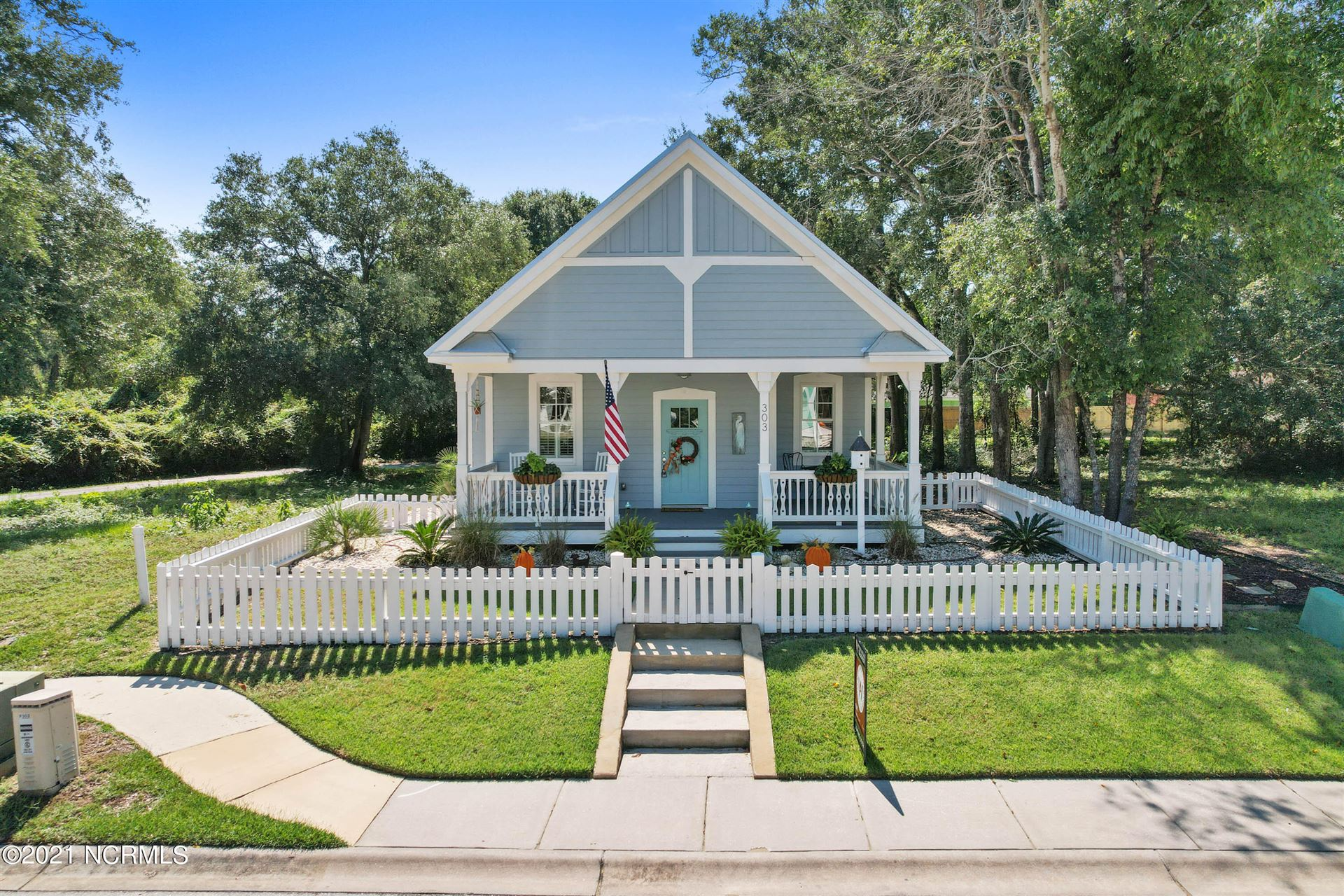 Photo of 303 Fire Fly Lane, Southport, NC 28461 (MLS # 100291941)