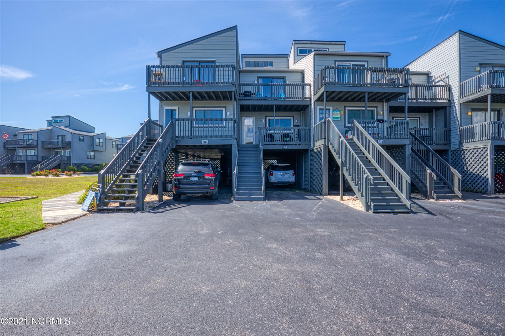 Photo of 1916 New River Inlet Road #Unit 204, North Topsail Beach, NC 28460 (MLS # 100278950)
