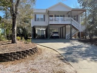 Photo of 110 NW 6th Street, Oak Island, NC 28465 (MLS # 100259957)