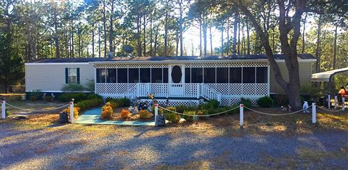 Photo of 1362 Woodcrest Road, Southport, NC 28461 (MLS # 100106984)
