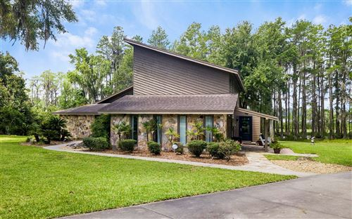 Photo of 302 NW CYPRESS COVE DR, Lake City, FL 32055 (MLS # 108103)