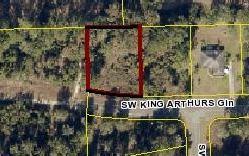 Photo of 137 SW KING ARTHURS GLN, Lake City, FL 32024 (MLS # 106238)
